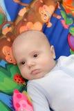 Μωρό στο χρωματισμένο υπόβαθρο Στοκ Εικόνες