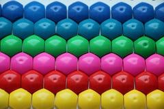 Μωσαϊκό παιδιών ` s υπόβαθρο του πολύχρωμου μωσαϊκού παιδιών ` s χρωματισμένα λωρίδες των πλαστικών λεπτομερειών του μωσαϊκού παι Στοκ φωτογραφίες με δικαίωμα ελεύθερης χρήσης