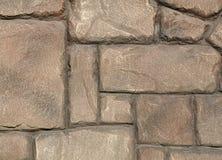 Μωσαϊκό των διαφορετικών πετρών επίστρωσης μεγεθών με το χρυσό χρώμα στοκ φωτογραφία