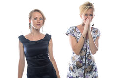 Μόνιμες γυναίκες στα φορέματα στο άσπρο υπόβαθρο Στοκ εικόνες με δικαίωμα ελεύθερης χρήσης