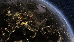 Μύγα πέρα από τα φω'τα πόλεων από το διάστημα μέχρι το πρωί απεικόνιση αποθεμάτων