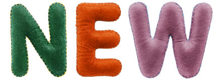 Νέα λέξη από τις πολύχρωμες επιστολές που απομονώνεται στο άσπρο υπόβαθρο Στοκ Φωτογραφία