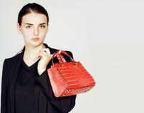 Νέα αρκετά δροσερή επιχειρησιακή κυρία μόδας που φορά το μαύρο κοστούμι και το ο Στοκ Εικόνες