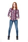 Νέα αρκετά σγουρή γυναίκα στο πουκάμισο καρό Στοκ Εικόνα