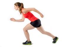Νέα γυναίκα έτοιμη να τρέξει τη φυλή Θηλυκός δρομέας αθλητικών αθλητών Στοκ Εικόνα