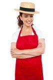 Νέα γυναίκα αρτοποιών που φορά το καπέλο σφαιριστών αχύρου Στοκ φωτογραφία με δικαίωμα ελεύθερης χρήσης