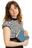 Νέα γυναίκα - δάσκαλος με ένα βιβλίο Στοκ Εικόνα