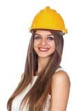 Νέα γυναίκα με ένα κράνος κατασκευής Στοκ εικόνα με δικαίωμα ελεύθερης χρήσης