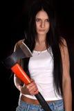 Νέα γυναίκα με ένα μεγάλο τσεκούρι Στοκ εικόνες με δικαίωμα ελεύθερης χρήσης