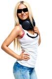 Νέα γυναίκα με τα ακουστικά Στοκ εικόνα με δικαίωμα ελεύθερης χρήσης