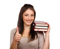 Νέα γυναίκα με τα βιβλία στοκ εικόνα με δικαίωμα ελεύθερης χρήσης