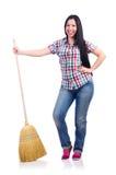 Νέα γυναίκα με τη σκούπα Στοκ Εικόνες