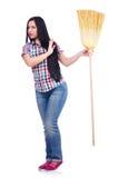 Νέα γυναίκα με τη σκούπα Στοκ Φωτογραφία