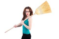 Νέα γυναίκα με τη σκούπα Στοκ φωτογραφίες με δικαίωμα ελεύθερης χρήσης