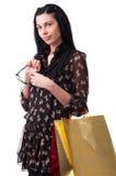 Νέα γυναίκα με τις τσάντες αγορών Στοκ Φωτογραφίες