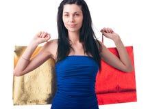 Νέα γυναίκα με τις τσάντες αγορών Στοκ Εικόνες