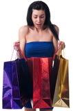 Νέα γυναίκα με τις τσάντες αγορών Στοκ εικόνα με δικαίωμα ελεύθερης χρήσης