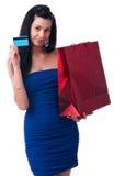 Νέα γυναίκα με τις τσάντες αγορών Στοκ εικόνες με δικαίωμα ελεύθερης χρήσης