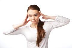 Νέα γυναίκα με τον πονοκέφαλο, ανησυχημένη. Στοκ Φωτογραφία