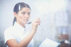 Νέα γυναίκα που επισύρει την προσοχή στο whiteboard με το άσπρο copyspace 15 woman young Στοκ εικόνες με δικαίωμα ελεύθερης χρήσης