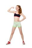 Νέα γυναίκα που κάνει τις αθλητικές ασκήσεις Στοκ Εικόνες