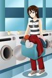 Νέα γυναίκα που κάνει το πλυντήριο Στοκ εικόνα με δικαίωμα ελεύθερης χρήσης