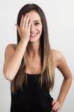 Νέα γυναίκα που καλύπτει ένα μάτι Στοκ φωτογραφία με δικαίωμα ελεύθερης χρήσης