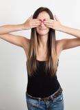 Νέα γυναίκα που καλύπτει τα μάτια της Στοκ Εικόνα