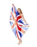 Νέα γυναίκα που κρατά μια μεγάλη διαφανή βρετανική σημαία Στοκ εικόνες με δικαίωμα ελεύθερης χρήσης