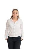 Νέα γυναίκα σε ένα άσπρο πουκάμισο στο άσπρο κλίμα Στοκ φωτογραφίες με δικαίωμα ελεύθερης χρήσης