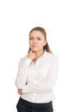 Νέα γυναίκα σε ένα άσπρο πουκάμισο στο άσπρο κλίμα στοκ εικόνες