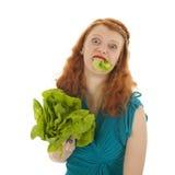 Νέα γυναίκα στη διατροφή στοκ φωτογραφία