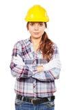 Νέα γυναίκα στο κίτρινο κράνος κατασκευής Στοκ εικόνα με δικαίωμα ελεύθερης χρήσης