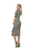 Νέα γυναίκα στο μακρύ ριγωτό φόρεμα που απομονώνεται επάνω Στοκ φωτογραφία με δικαίωμα ελεύθερης χρήσης