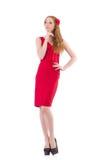 Νέα γυναίκα φόρεμα που απομονώνεται στο κόκκινο στο λευκό Στοκ Εικόνες