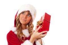 Νέα γυναίκα Χριστουγέννων με ένα παρόν Στοκ φωτογραφία με δικαίωμα ελεύθερης χρήσης