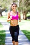 Νέα γυναίκα Jogging στοκ εικόνες με δικαίωμα ελεύθερης χρήσης