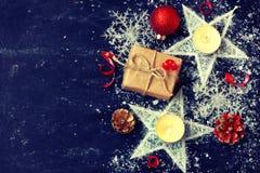 νέα διακόσμηση έτους Χριστουγέννων, κεριά, κιβώτιο δώρων, αστέρι, snowflak Στοκ Εικόνα