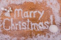 Νέα επιγραφή ετών Χριστουγέννων στο υπόβαθρο Στοκ Εικόνες
