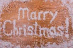 Νέα επιγραφή ετών Χριστουγέννων στο υπόβαθρο Στοκ εικόνες με δικαίωμα ελεύθερης χρήσης