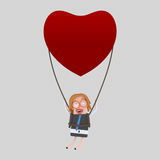 Νέα επιχειρηματίας που ταξιδεύει σε ένα μπαλόνι καρδιών Στοκ εικόνες με δικαίωμα ελεύθερης χρήσης