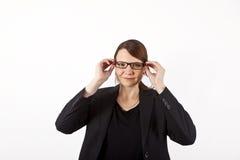 Νέα επιχειρησιακή γυναίκα με τα γυαλιά στοκ φωτογραφία
