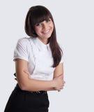 Νέα επιχειρησιακή γυναίκα με το κύτταρο στο χαμόγελο χεριών στοκ φωτογραφία με δικαίωμα ελεύθερης χρήσης