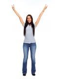 Νέα ευτυχής γυναίκα που φορά τα τζιν και την μπλούζα Στοκ εικόνες με δικαίωμα ελεύθερης χρήσης