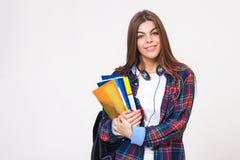 Νέα ευτυχής γυναίκα σπουδαστής με τα βιβλία που απομονώνεται Στοκ Εικόνες