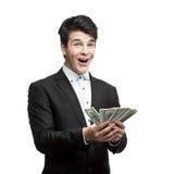 Νέα ευτυχή χρήματα εκμετάλλευσης επιχειρηματιών Στοκ εικόνα με δικαίωμα ελεύθερης χρήσης