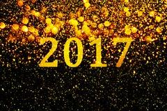 Νέα διακόσμηση έτους, κινηματογράφηση σε πρώτο πλάνο στα χρυσά υπόβαθρα Στοκ Εικόνες