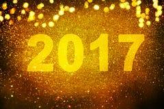 Νέα διακόσμηση έτους, κινηματογράφηση σε πρώτο πλάνο στα χρυσά υπόβαθρα Στοκ Φωτογραφία