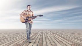 Νέα κιθάρα παιχνιδιού στοκ φωτογραφία με δικαίωμα ελεύθερης χρήσης