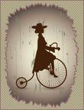 Νέα κυρία και αναδρομικό ποδήλατο Στοκ Εικόνα